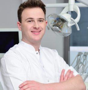 Łukasz Głuszek, dobry ortodonta warszawa, ortodoncja